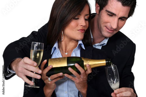 Couple celebrating with a glass of wine