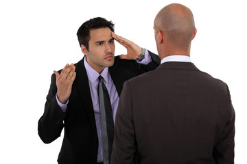 Two businessmen not seeing eye to eye