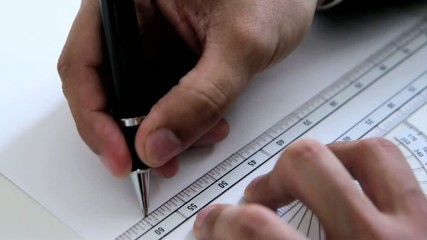 Man drawing a blueprint