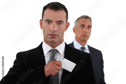 Businessman receiving card