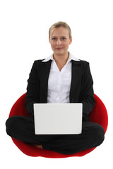 Businesswoman sat cross-legged
