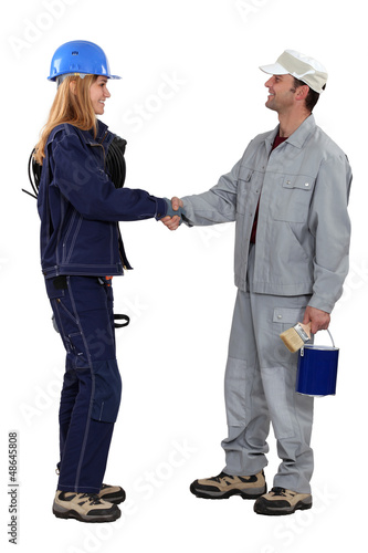 A painter and an electrician shaking hands.