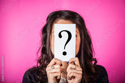 Doubtful Woman holding Question Mark