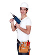 Young tradesman holding an electric screwdriver