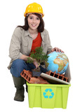 Female builder with recyclable waste