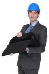 businessman wearing helmet opening his briefcase