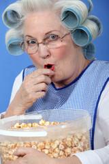 Granny eating caramel popcorn