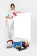 Decorator stood by blank advertisement board holding roller