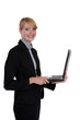 Businesswoman standing with a laptop