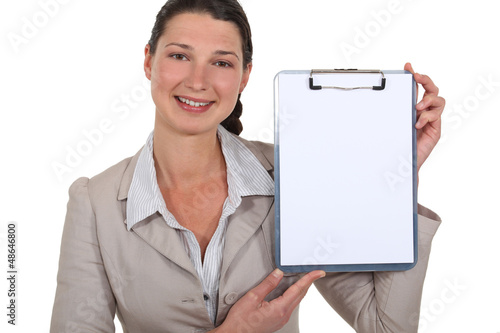 Businesswoman pointing to blank clip-board