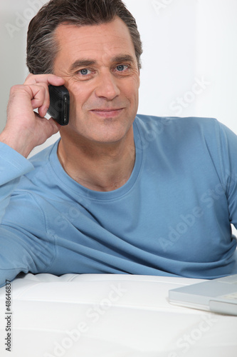 Casual older man on the phone