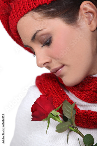 Brunette smelling rose