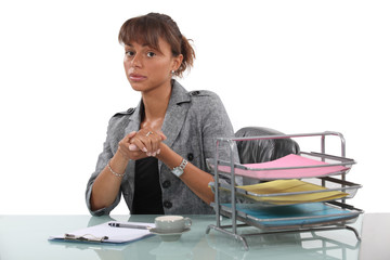 Woman sitting in office with coffee cup