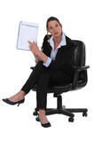 businesswoman pointing at notepad