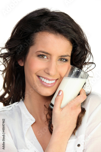 Cheerful woman holding milk