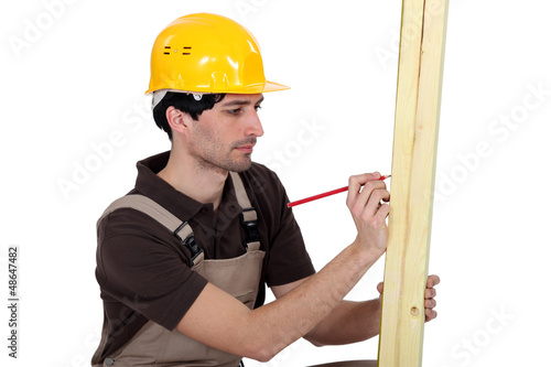 Carpenter marking wood