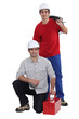 Plumber and electrician working as team