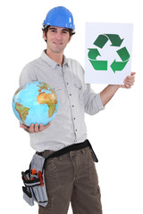 Laborer holding a globe and a symbol of recycling