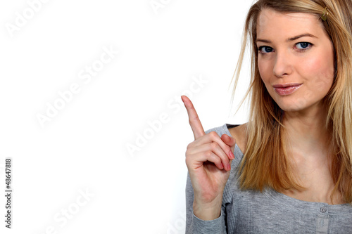 Woman raising her finger