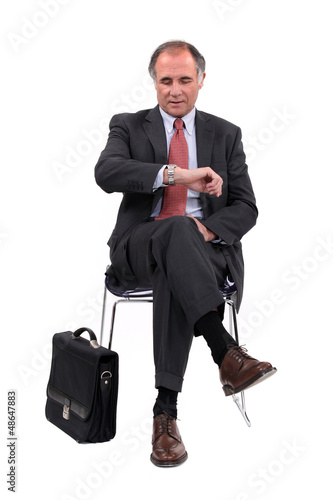 businessman consulting his watch