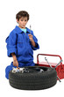 portrait of schoolboy dressed as garage mechanic