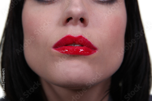 Closeup of a woman's red lips