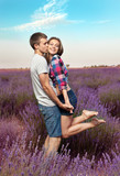 Young couple playing around in the lavender fields