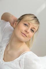 Romantic blonde woman in white