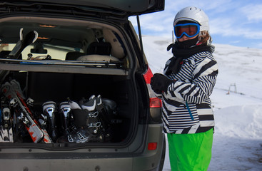 Girl with ski by the car