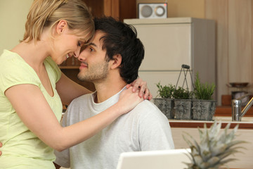 Couple touching foreheads at home