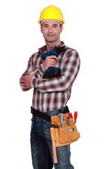 Handyman posing with cordless drill