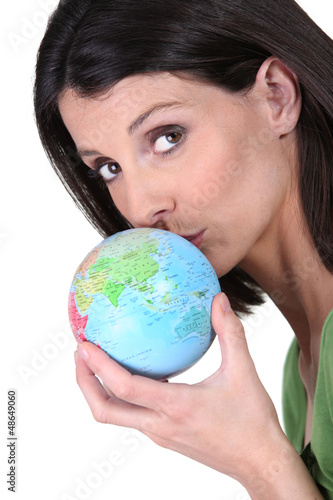 Woman kissing globe