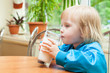 Little girl is drinking milk