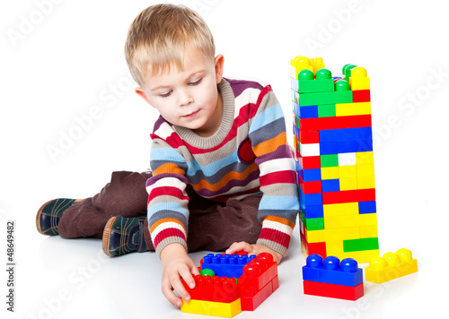 a funny boy is playing with lego
