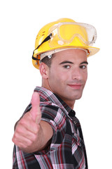 Man with hard hat and goggles giving thumbs-up