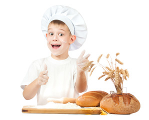 funny little kid is kneading dough