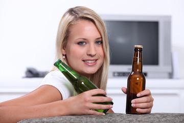 Teenage girl with beer