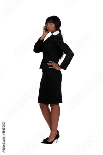 An African American businesswoman over the phone.