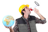 craftsman shouting through a megaphone and holding a globe