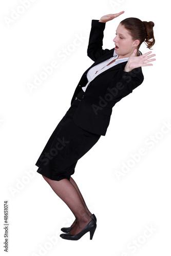 Businesswoman struggling to keep balance
