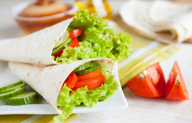 lettuce and tomatoes wrapped in pita bread