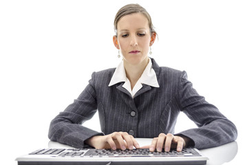 Business woman typing on keyboard