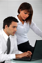 Colleagues writing an e-mail together