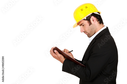 Surveyor writing on a clipboard