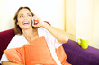 Beautiful woman talking on the phone smiling at home