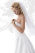 pretty blonde bride with hand on the breast