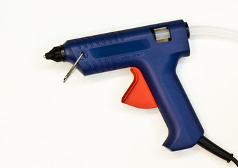 gun to glue plastic on a white background