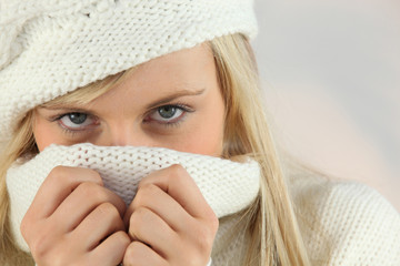 Woman covering her face with her sweater