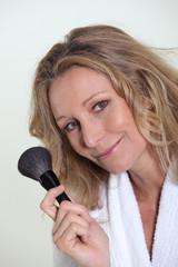 Woman holding blusher brush