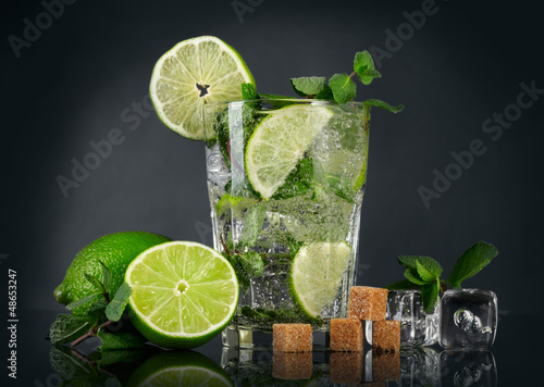 Mojito cocktail over black background